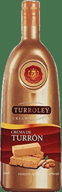 11,95 € Envío gratis | Crema de Licor Turroley Crema de Turrón España Botella 70 cl